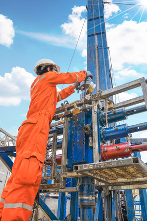 Offshore oil rig worker prepare tool and equipment for perforation gases well at wellhead remote platform, Oil and gas production and exploration industry job in Thailand.