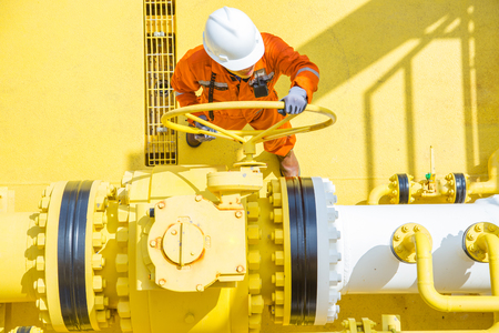 Offshore oil and gas operations, production operator open valve to allow gas flowing to sea line pipe for sent gases and crude oil to central processing platform.