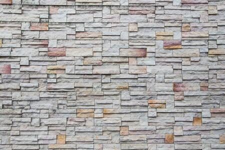 White and orange rust brick wall background. Stockfoto