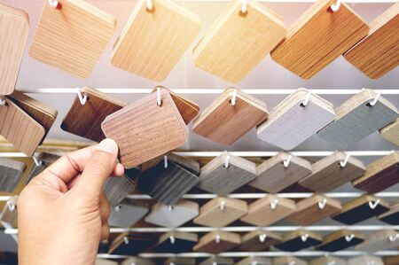 Sample of wood laminate board. Wooden laminate veneer material for interior architecture and construction or furniture finishing design concept