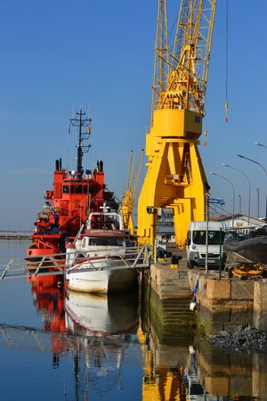 Crane and boat from the beach of Huelva