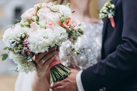 Wedding floristry in the hands of the bride.