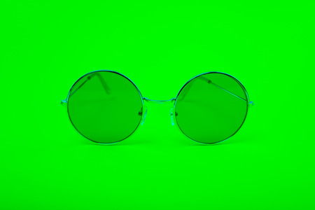 Bright green glasses on a green background.