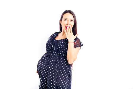 Surprised pregnant Woman waiting for her child. Фото со стока