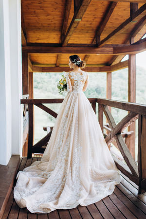 The bride in a magnificent, white, wedding dress with a long train.