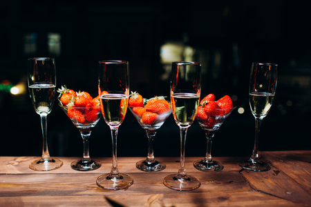 Champagne in a glass with strawberries in night. Reklamní fotografie