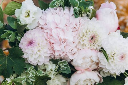 Wedding asymmetric bouquet of eustoma, peonies, dahlias, hydrangeas. Stock Photo