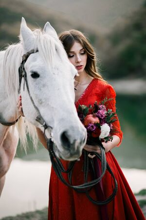 Princess in a red dress from a fairy tale. Stock Photo