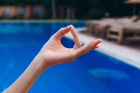 Practice yoga at the pool. Search for harmony and awareness of yourself.