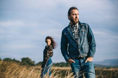 Girlfriend and boyfriend walk in the field.