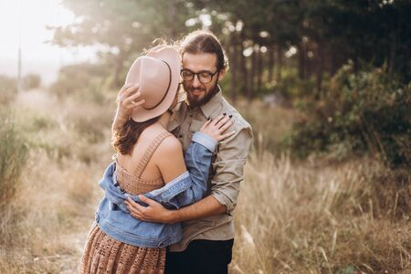 Boyfriend and Girlfriend hug each other in nature. Stock Photo - 128570543