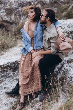 Boyfriend and Girlfriend hug each other in nature.