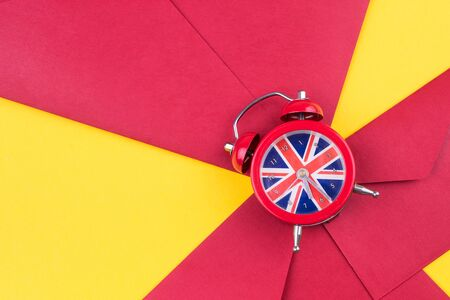 English clock with the colors of the British flag. Time to learn English.