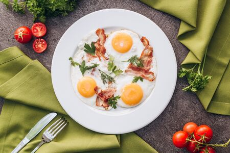 Perfect breakfast with bacon and eggs in the morning.