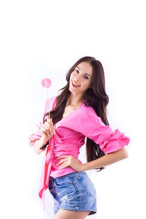 Cheerful Bright Girl in pink clothes with sweet candy on isolated white background.