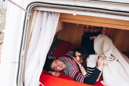 Loving couple alone in a trailer on a trip. Romance for lovers. Banco de Imagens