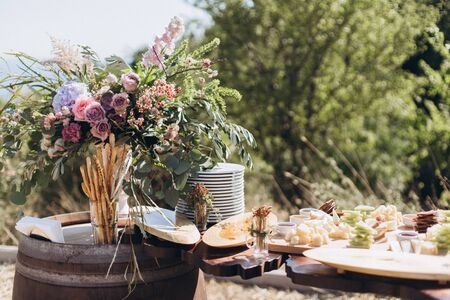 Boho wedding table with eco decor for guests.