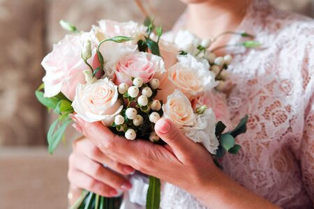 Pale pink bridal bouquet with delicate pink flowers.