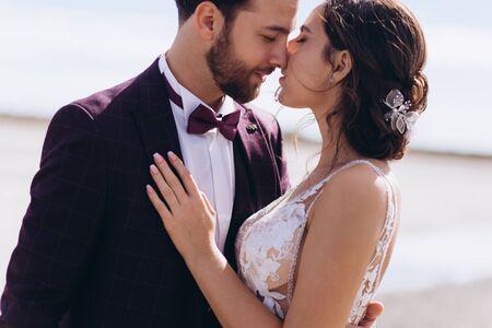Kiss love bride and groom. Happy together Reklamní fotografie
