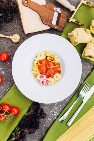 Pasta on a gray background with decorations for advertising the menu. 스톡 콘텐츠