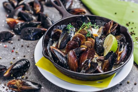 Baked Mediterranean mussels with lime. Sea Food.