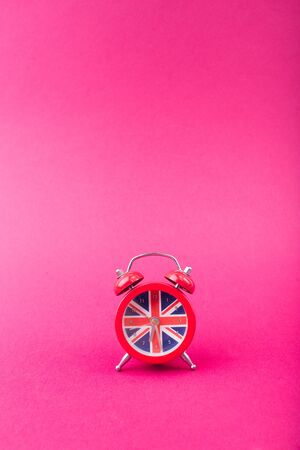 English clock with the colors of the British flag. Time to learn English.-Image