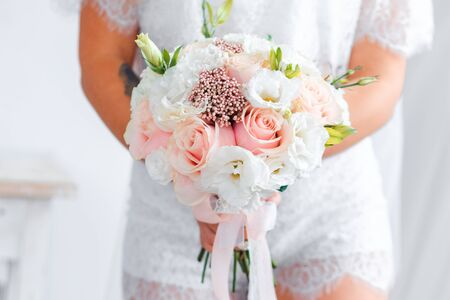 Delicate classic wedding bouquet of roses for the bride. Wedding flowers.