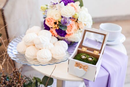 Delicate classic wedding bouquet of violet roses for the bride. Wedding flowers.