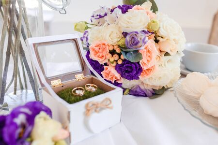 Delicate classic wedding rings for bride and groom.