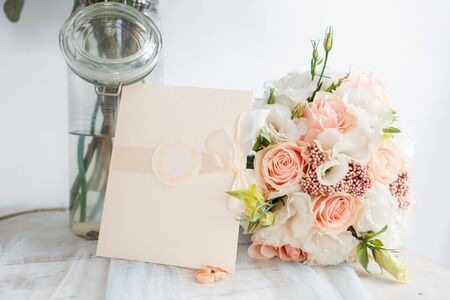Delicate classic wedding bouquet of roses for the bride. Wedding Letter. Wedding flowers.