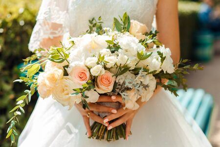 Delicate classic wedding bouquet of roses for the bride. Wedding flowers.-Image