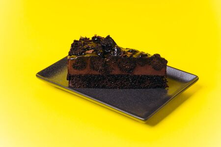 Chocolate Pie on a yellow background for cafe menu with coffee decoration with mendal.