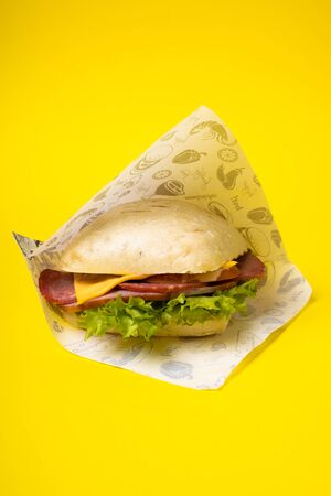 Sandwich on the yellow background. Fastfood. Burgeer.