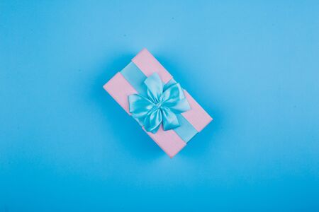 blue-pink gift on a blue background. Image