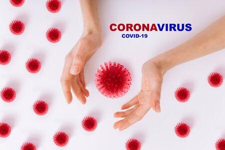 The concept of coronavirus quarantine. New Coronavirus (COVID-19). Hands reach for coronovirus. Clean hands fights coronavirus (COVID-19). Pandemic 2019-2020.
