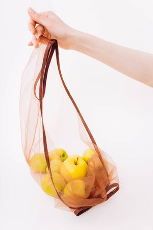Eco packs. No waste. Eco bag with apples. Purchase without harm to nature in anti-plastic bags. Zero Waste. 版權商用圖片
