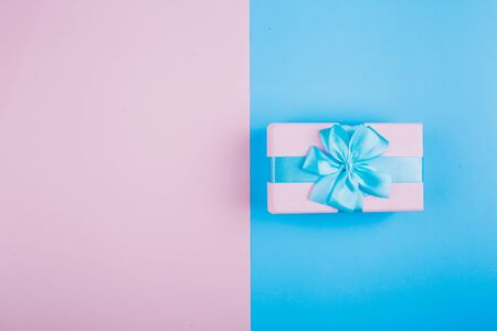 Blue-pink gift on a blue and pink background.