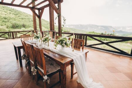 Decorated wedding table for the newlyweds and guests. Wedding decor and Floristics.