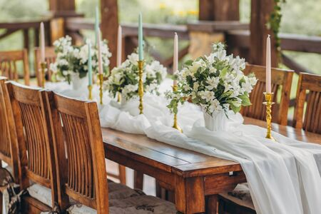 Decorated wedding table for the newlyweds and guests with mountain views. Wedding decor and Floristics. 版權商用圖片