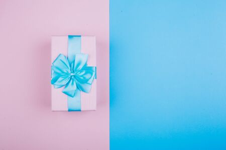 blue-pink gift on a blue and pink background. Image