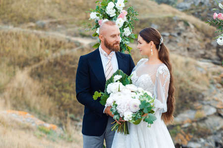 Wedding couple by the sea in boho style.