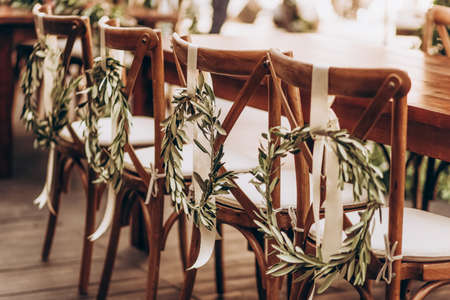 Boho wedding chair with eco decor for guests. Standard-Bild