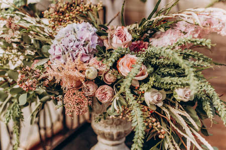 Wedding arrangement of natural flowers in boho style.