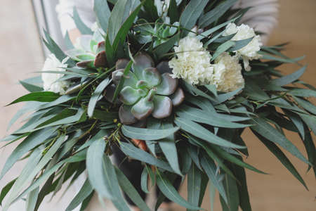 Boho greenary eco style wedding bouquet of succulent. Standard-Bild