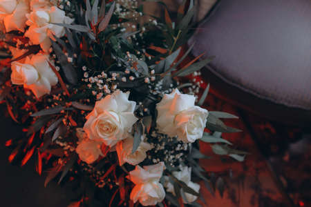 Boho style wedding bouquet of white roses. Standard-Bild