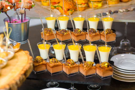 Catering service. Table with snacks food at event. Standard-Bild