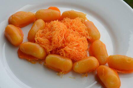Thai sweet khanom medkhanoon - ingredients; egg yolk,sugar, mung bean