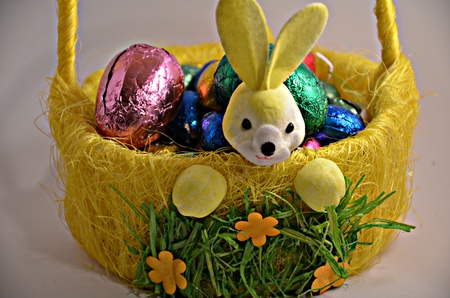 Chocolate eggs in the basket for Easter Stock Photo