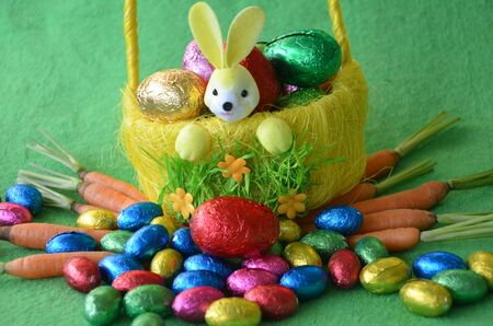 Decorative basket full with Easter eggs and carrots Stock Photo