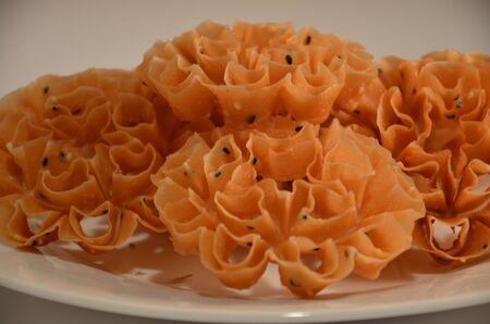 Close up picture of Khanom Dawk Jawk Thai snack- ingredients; sugar, rice,sesame seeds, sesame oil